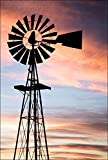Photograph of the vintage rustic farm windmill. This country ranch setting at sunset was a beautiful scene.