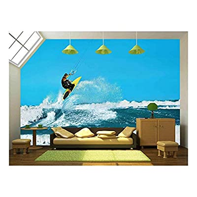 Recreational Water Sports Action. Healthy Man (Surfer) Kiteboarding (Kite Surfing) on Waves in Sea, Ocean - Removable Wall Mural | Self-Adhesive Large Wallpaper - 66x96 inches