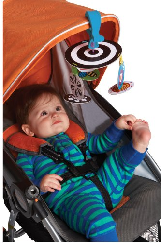 Child stages of play: Young baby in a stroller looking at a Toy
