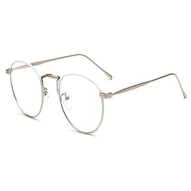 0bee68ac6c64e Hzjundasi Ovale Des lunettes pour Femme et Homme Lentille claire Vintage  Métal Cadre Mode Lunettes UV400 Anti-fatigue  Amazon.fr  Vêtements et  accessoires