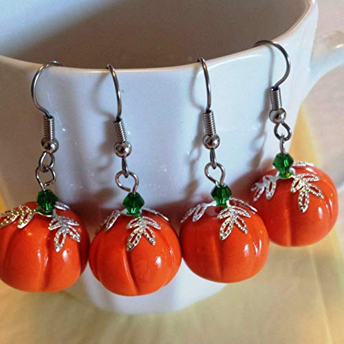 Pumpkin earrings. Made from Polymer Clay with Green Crystals.