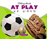 img - for At Play / En El Juego (Talking Hands) (English and Spanish Edition) book / textbook / text book