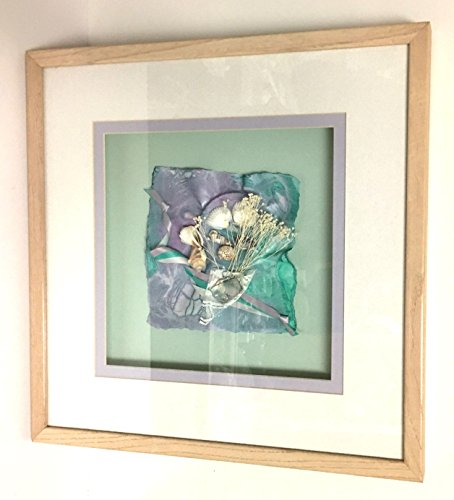 (Framed fabric and sea shells collage.)