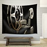wall26 - Close-up of the film reels on a vintage 8mm film projector in a dark room - Fabric Wall Tapestry Home Decor - 68x80 inches