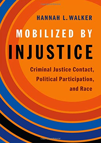 Mobilized by injustice : criminal justice contact, political participation, and race