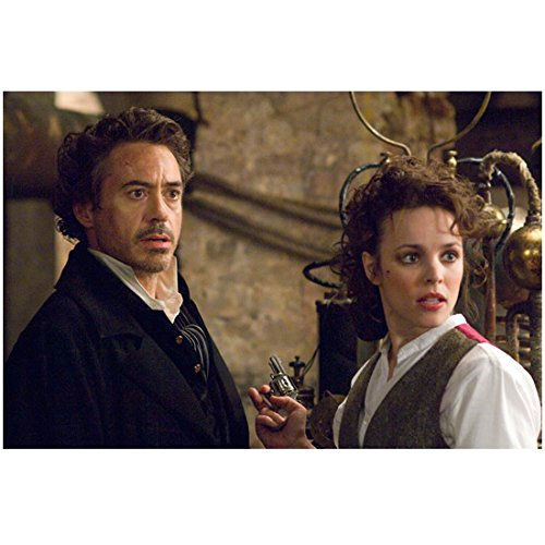 Sherlock Holmes (2009) 8 inch x 10 inch PHOTOGRAPH Robert Downey, Jr. Black Overcoat & Rachel McAdams Holding Tiny Gun kn]()