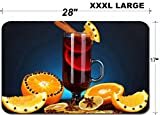 Luxlady Large Table Mat Non-Slip Natural Rubber Desk Pads IMAGE ID: 22351563 Fragrant mulled wine in glass with spices and oranges around on blue bac