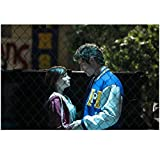 Awkward Ashley Rickards as Jenna Hamilton and Beau Mirchoff as Matty McKibben embracing behind a fence 8 x 10 Inch Photo