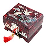 This wooden bird music box is elegantly embellished with mother of pearl design of a pair of cranes delighting in a romantic moment on a pine tree wrought by the intricate mother of pearl inlaying technique. The harmony between the colored Ko...