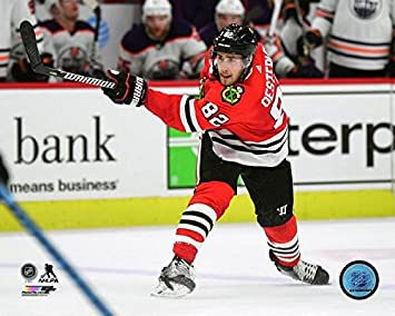 Amazon.com  Jordan Oesterle Chicago Blackhawks 2017-18 NHL Action ... 048da847f