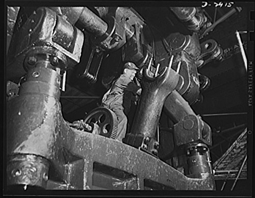 Crank Connecting Rod - 1942 Photo Conversion. Automobile plant. Preparing to swing back and clear the long toggle arm of a huge 90T96 Cleveland press so the large connecting rod can be brought in place under the crankshaft.