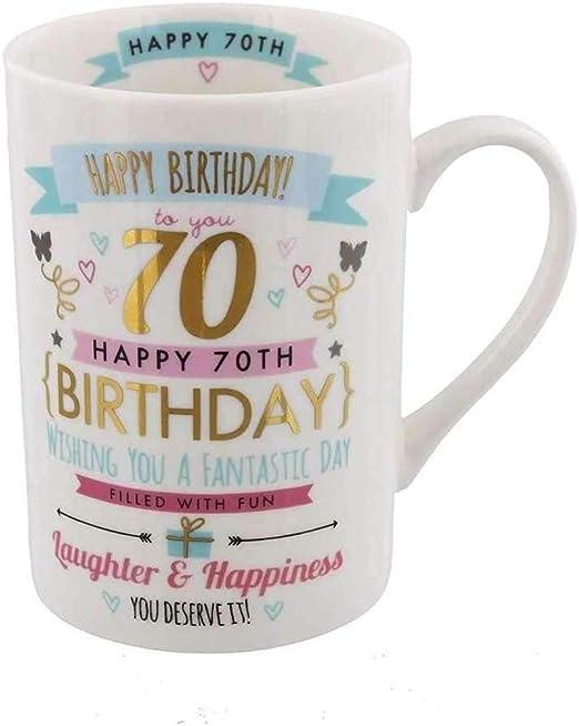 Taza de 70.º cumpleaños de señoras con signografía en rosa y oro (con texto en inglés).