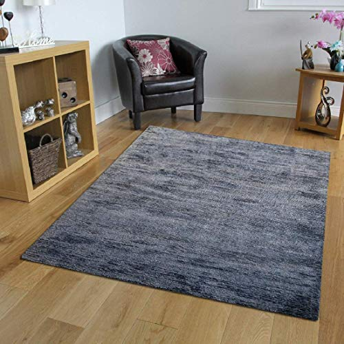 Carpet Couture Area Rug Hand Loom Contemporary Design Stylized Pattern Ground color Grey 100% Dry Clean Only with One Year Warranty (4'6