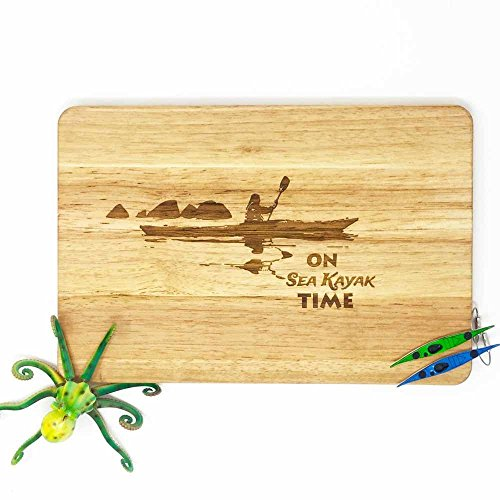 Kayaker cutting board.Paddlers present. Kayak, canoe and paddle fans.Ocean lovers gift.Wooden Chopping board with a sea theme.Practical art.Nautical ideas. ()