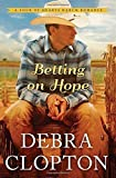img - for Betting on Hope (A Four of Hearts Ranch Romance) Paperback February 24, 2015 book / textbook / text book