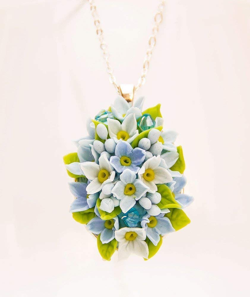 Blue flower stamped clay necklace