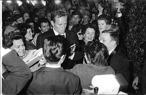 Vintage photo of Charlton Heston giving autographs.