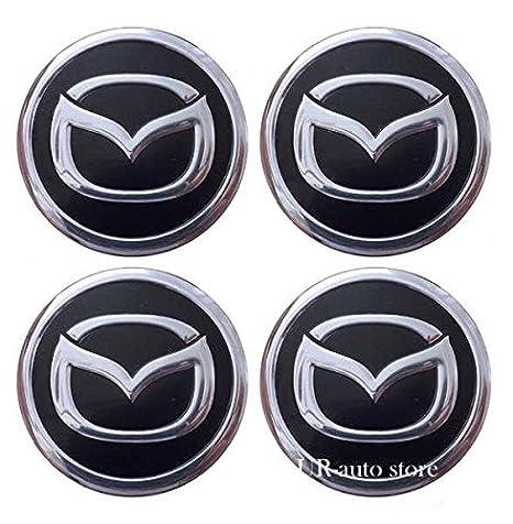 4 emblemas adhesivos de aluminio para tapacubos de 60 mm: Amazon.es: Coche y moto