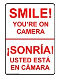 ComplianceSigns Vinyl Security Camera Label, 5 x 3.5 in. with English + Spanish, 4-Pack White