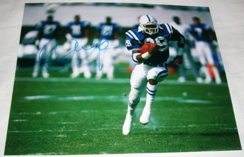 B007ZUL3P4 Eric Dickerson Autographed Indianapolis Colts 8x10 Photo W/PROOF, Picture of Eric Signing For, Los Angeles Rams, Indianapolis Colts, Los Angeles Raiders, Atlanta Falcons, SMU Mustangs, Pony Express 51YFg41LCbL