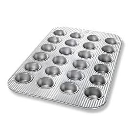 USA Pan Bakeware Mini Cupcake and Muffin Pan, Nonstick Quick Release Coating, 24-Well, Aluminized Steel 1 Mini Cupcake or Muffin Pan has 24 wells; commercial grade and heavy gauge aluminized steel with a lifetime warranty USA Pan baking pans feature Americoat which promotes quick release of baked-goods plus fast and easy clean up; wash with hot water, mild soap and gentle scrub brush or sponge Nonstick Americoat coating - a patented silicone coating which is PTFE, PFOA and BPA free - provides quick and easy release of all baked-goods and minimal easy clean up