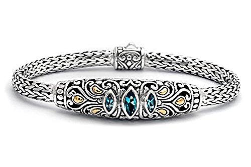 Gold and Silver bracelet with Blue topaz sky, Bali motif.