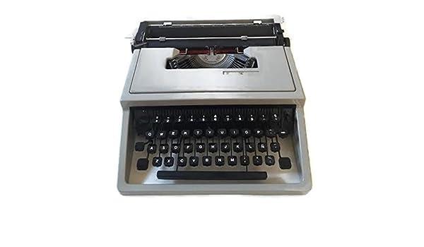 Maquina de escribir olivetti Dora vintage: Amazon.es: Oficina y papelería