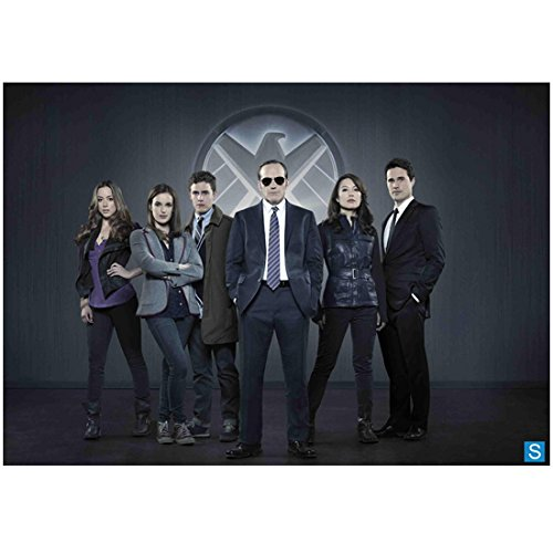 Agents of- S.H.I.E.L.D. (8 inch by 10 inch) PHOTOGRAPH Clark Greg Hands in Pockets Sunglasses & Cast in Front of S.H.I.E.L.D. Logo Pose 2 - Sunglasses L Agent
