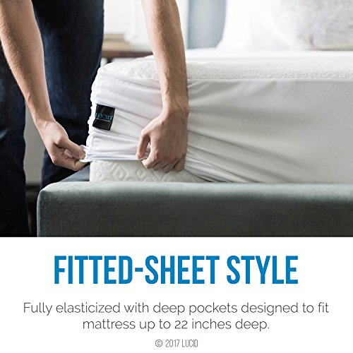 man wrapping the LUCID Mattress Protector around a mattress