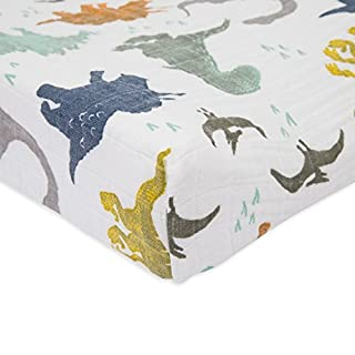 """Little Unicorn Cotton Muslin Changing Pad Cover – 16""""x 32"""" - 100% Cotton – Machine Washable – Standard Size - Stitched Holes for Safety Straps – Lightweight, Breathable Design (Dino Friends)"""