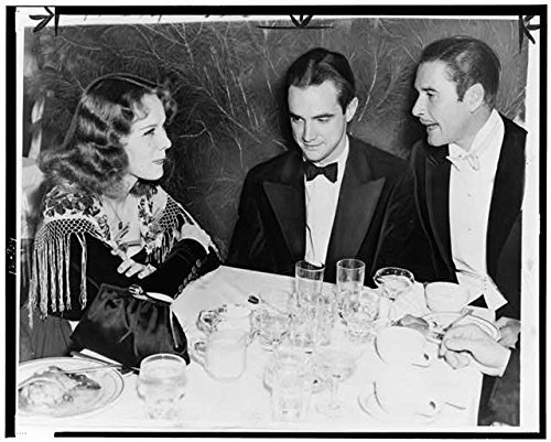 Photo: Howard Hughes, Helen Gilbert, Errol Flynn, Charity Christmas Party, Beverly HIlls, CA . Size:
