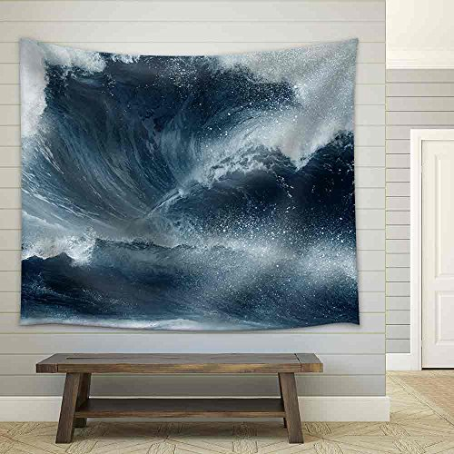 Huge Tidal Wave Crashing Onto the Beach with Man Fabric Wall
