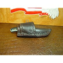 Size 5 1/2 Custom Cross Draw Sheath Far a Schrade Ph 2 Knife. . The Sheath Can Be Worn on the Right or Left Hand Side. Comes with a Border Tooling dyed dark brown. This Is for Sheath Only Knife Not Included.