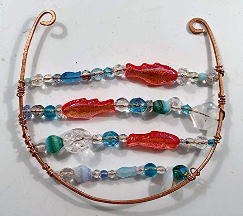 Decorative, hammered Copper decorated with faceted glass beads, bright orange goldfish and mostly turquoise, blues, greens and clear