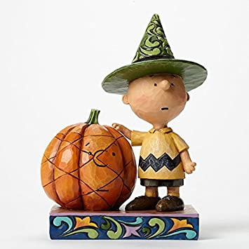 Jim Shore for Enesco Peanuts Charlie Brown with Pumpkin Figurine, 6.75