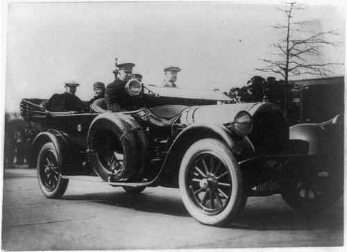 Photo: President & Mrs. Wilson on first auto ride after his illness
