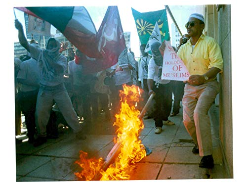 Vintage photo of Israel hebron mosque massacre:muslim protestors burn an israel flag outside the united -