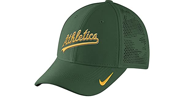 c7f06b1d0ef21 Amazon.com  Nike Men s Oakland A s Vapor Performance Flex Cap One Size  Green Yellow  Sports   Outdoors