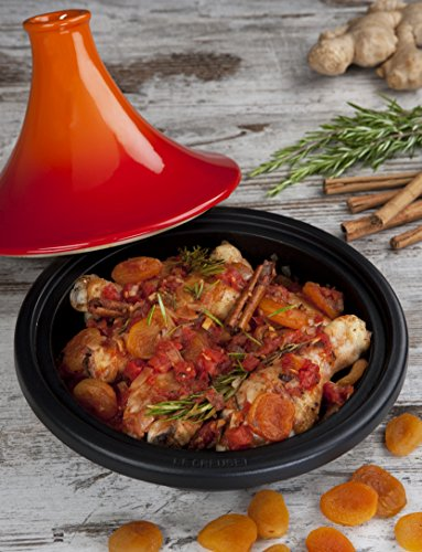 Le creuset enameled cast iron moroccan tagine, 2. 5 qt. , flame 2 durable interior enamel requires no seasoning stoneware lid circulates heat and moisture the cast iron base is designed for browning vegetables and meat on the stovetop, but doubles as a tortilla warmer in the oven
