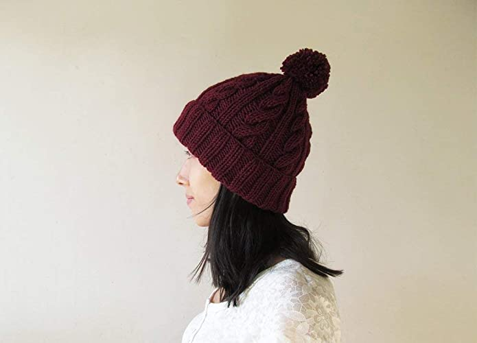 54a786c2757 Amazon.com  Cable Knit Hat in Burgundy