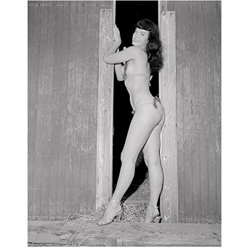 (Bettie Page 8 inch by 10 inch PHOTOGRAPH Teaser Girl in High Heels Teaserama Bettie Page Reveals All B&W Pic Full Body Leaning on Barn Door kn)