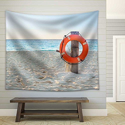 Life Preserver on Sandy Beach Somewhere in Mexico Fabric Wall