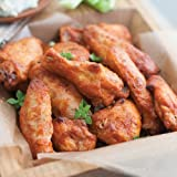Add some kick to your get together with these hot and spicy sauced chicken wings. They're juicy and big, and easy to make in the oven or microwave and serve. Hot (Buffalo-style) wings are the perfect party appetizers, or serve them up as quick meal w...