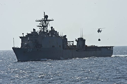 Home Comforts Laminated Poster an SA-330J Puma Helicopter Delivers Cargo to The Amphibious Dock Landing Ship USS Carter Hall (LSD 5 Vivid Imagery Poster Print 24 x 36