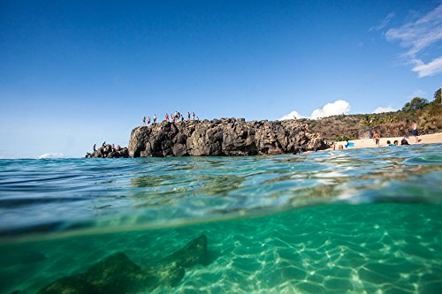 Split-shot view from the ocean of beachgoers standing on top of the famous jump rock at Waimea Bay, Oahu, Hawaii print picture photo photograph fine art (Photo Jump Shot)