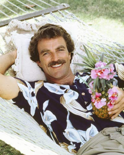 Tom Selleck in Magnum, P.I. iconic in Hawaiian shirt on hammock with drink 8x10 Promotional Photograph