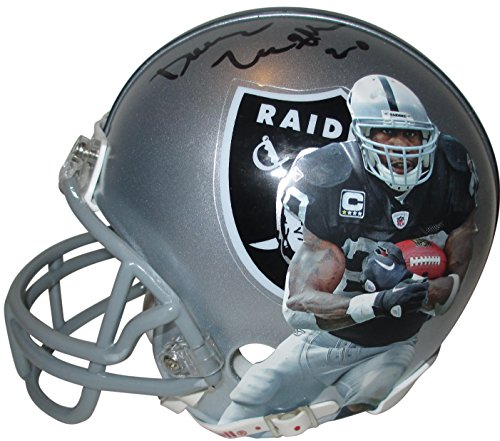 - Oakland Raiders Darren McFadden Autographed Hand Signed Raiders Photo Riddell Mini Football Helmet with Proof Photo of Signing and COA- Arkansas Razorbacks