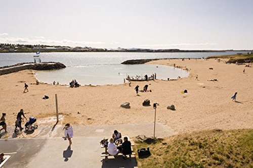 People enjoying the day at Nautholsvik beach, Reykjavik Iceland. The water in the lagoon is heated using geothermal water. 30x40 photo reprint by PickYourImage
