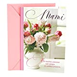 """Offer your love and admiration for your mother on her birthday with this card featuring a photo of pink-hued flowers in a white vase. The message on the front of the card reads, """"Mami En nuestros corazones está siempre tu cariñosa presencia.""""..."""