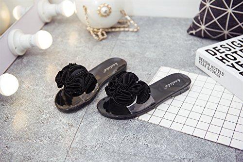LIVY La nueva manera de desgaste exterior flor femenina jalea de las sandalias y zapatillas palabra camelia arrastrado Sra verano con sandalias Negro